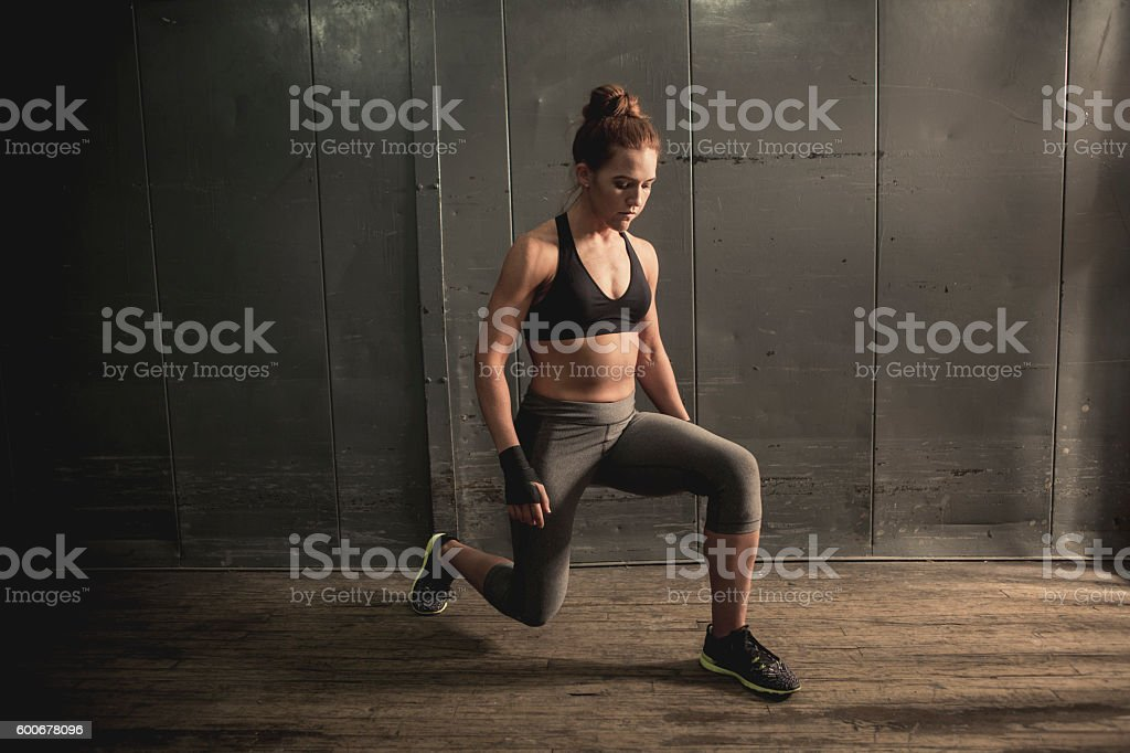 Athletic Woman Doing Lunges stock photo