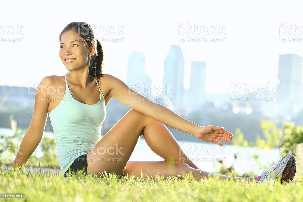 Athletic woman doing stretching exercises outdoors royalty-free stock photo
