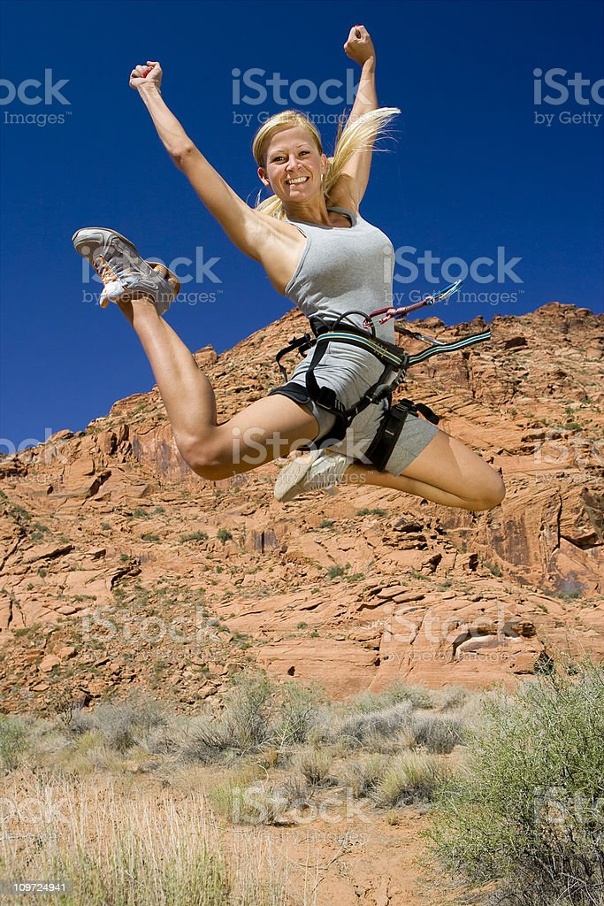 Athletic Woman Jumping for Joy royalty-free stock photo