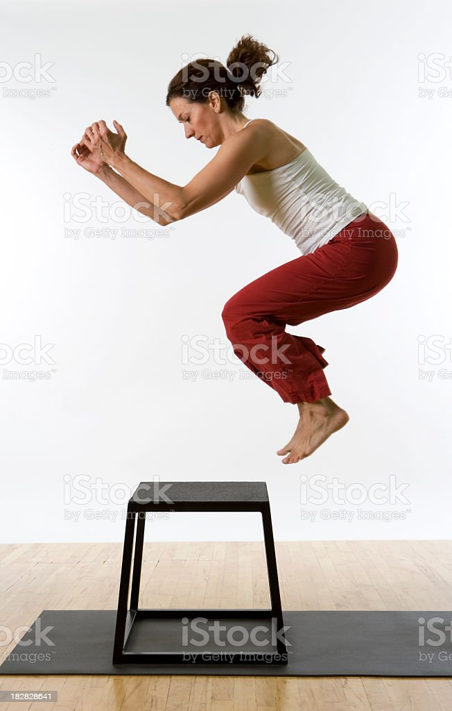 Athletic Woman Jumping On to Workout Platform. royalty-free stock photo