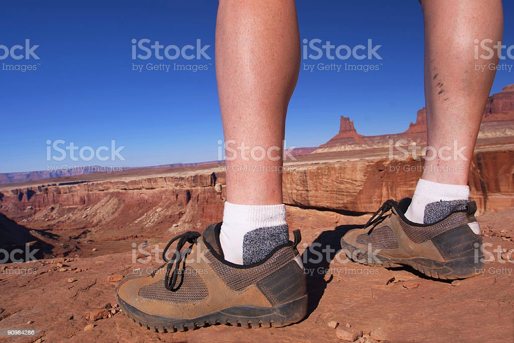 athletic woman legs and desert sandstone landscape royalty-free stock photo