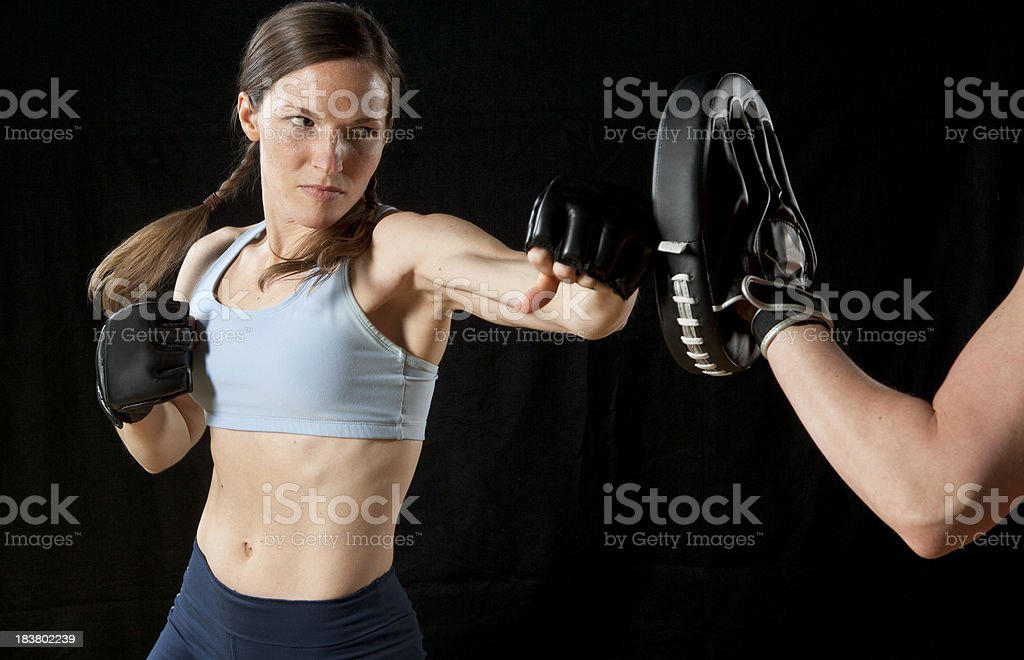 Athletic Woman Practicing Boxing With Trainer. royalty-free stock photo