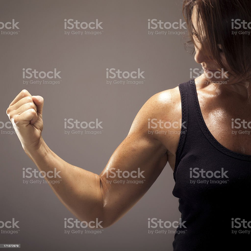 Athletic Woman Showing Her Right Bicep royalty-free stock photo