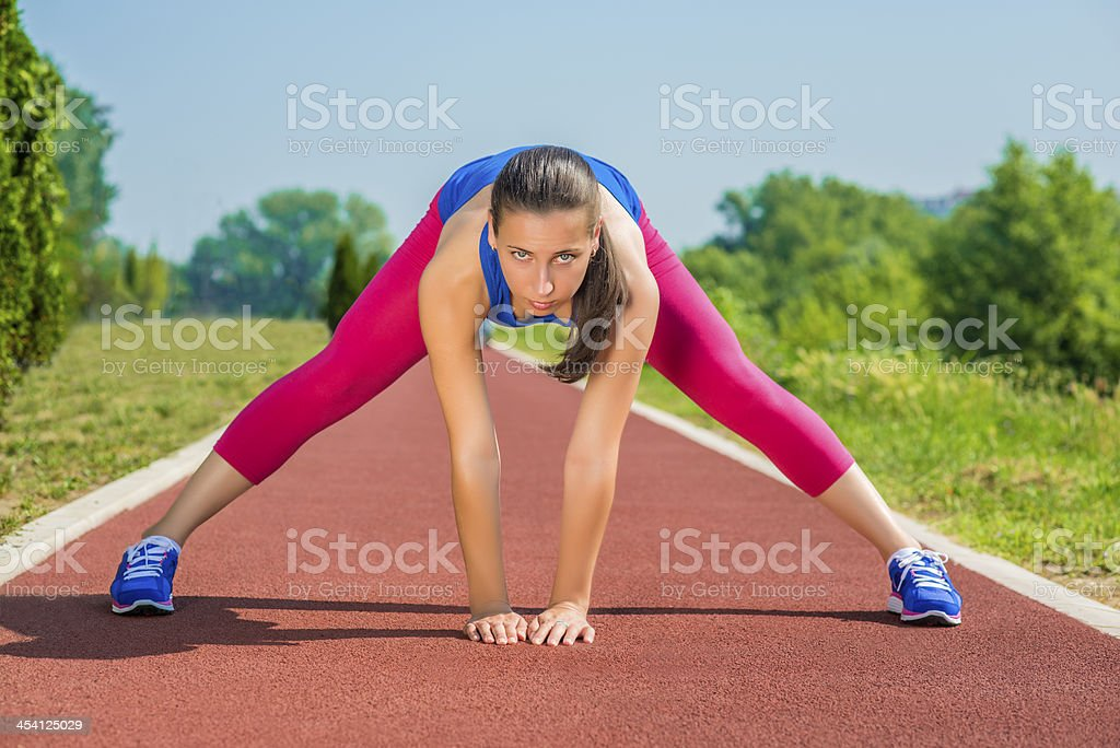 Athletic Woman - Stretches royalty-free stock photo