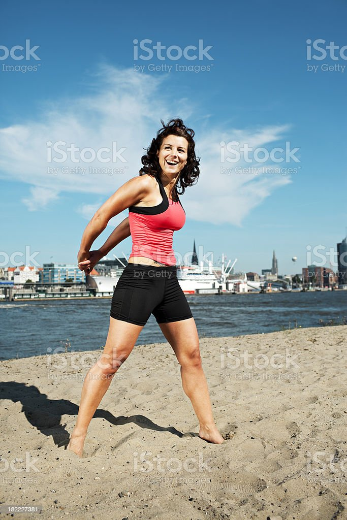 athletic woman stretching royalty-free stock photo