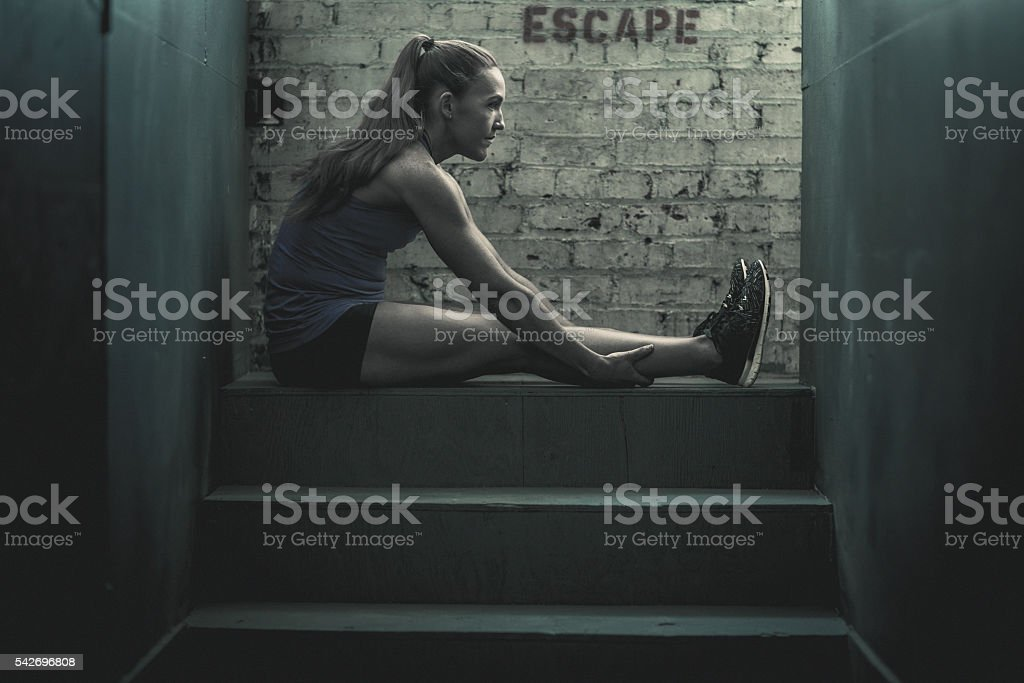 Athletic Woman Stretching stock photo