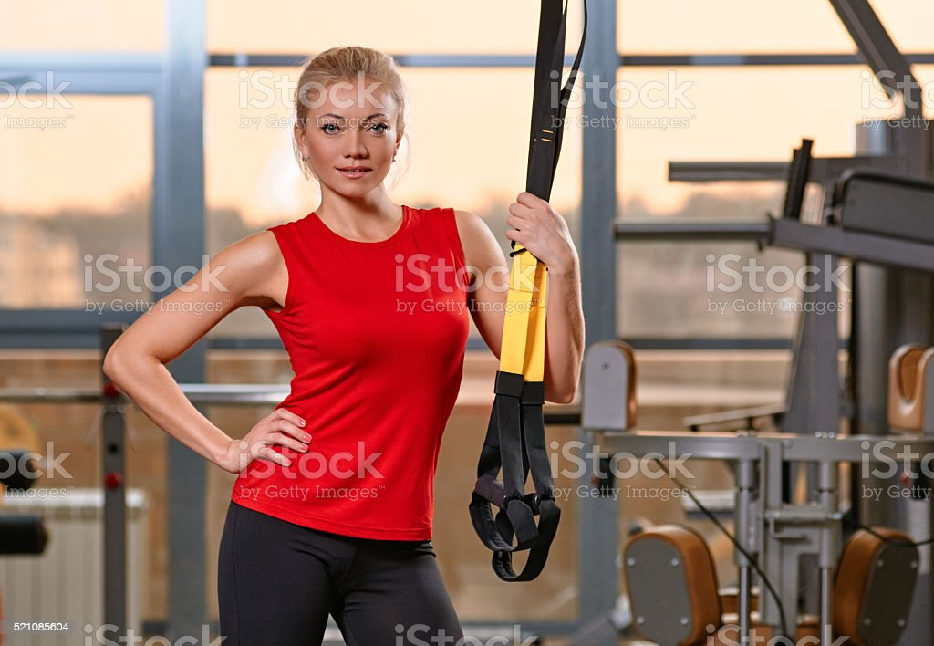 Athletic woman trx stock photo