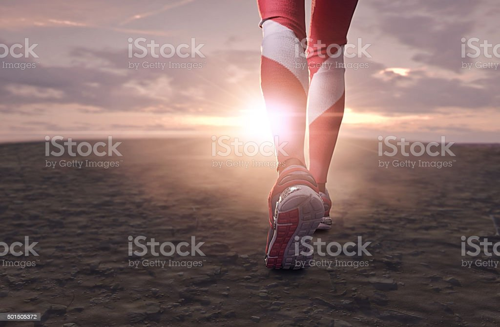 athletic woman walking stock photo