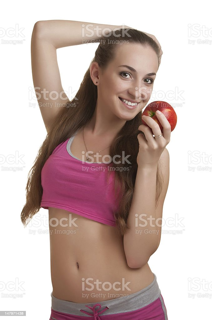 Athletic woman with apple royalty-free stock photo