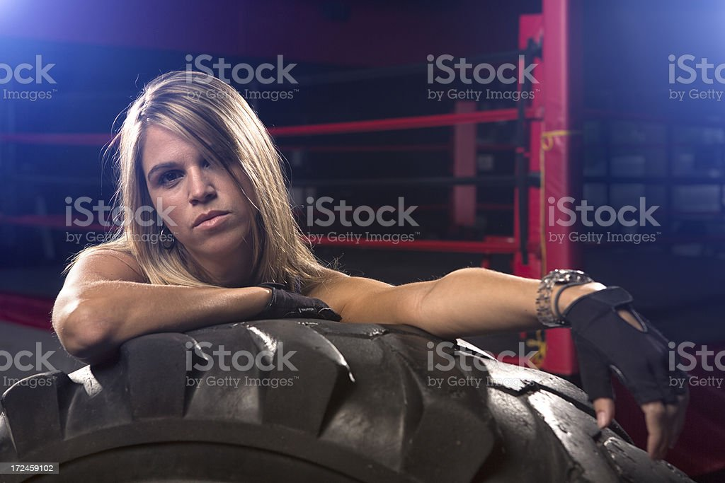 Athletic woman with gym Tire royalty-free stock photo