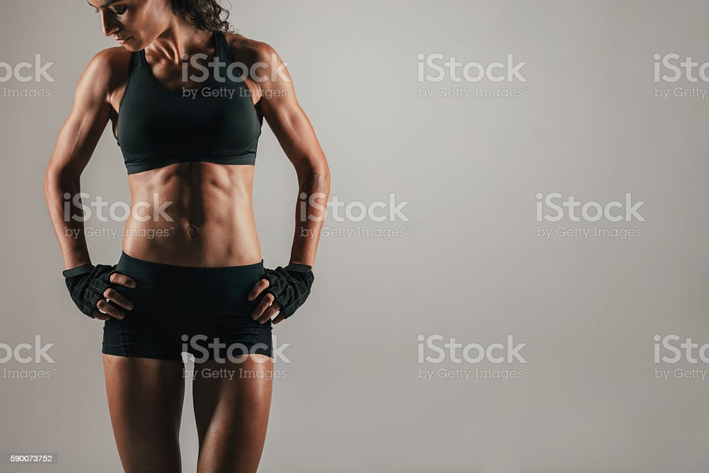 Athletic woman with strong abdominal muscles stock photo