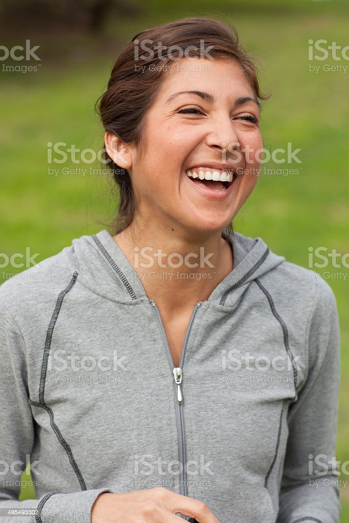 Athletic young Hispanic woman in workout clothing stock photo