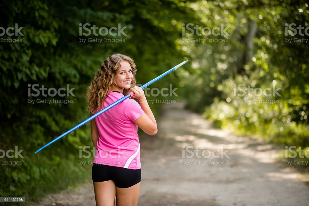 Athletic young woman carrying a javelin stock photo