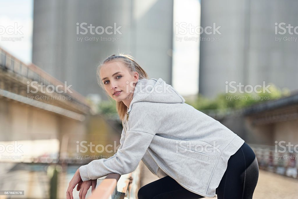 Athletic Young Woman Resting Before Her Workout. stock photo