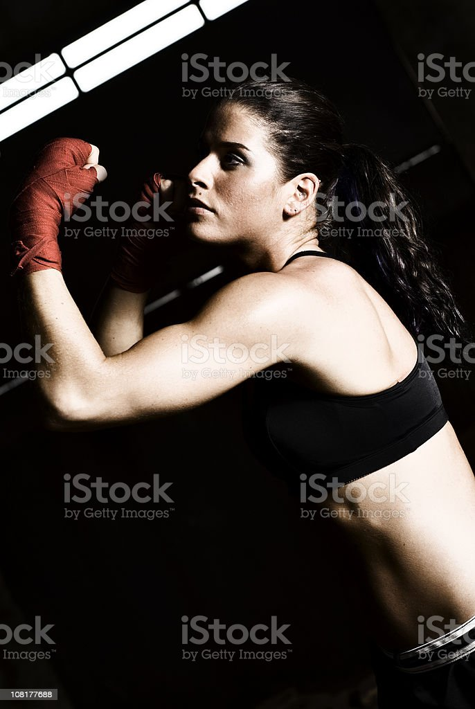 Athletic Young Woman Wearing Boxing Gloves and Training royalty-free stock photo
