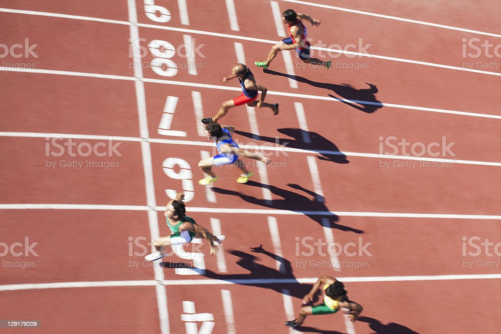 Athletics runners at track and field event royalty-free stock photo
