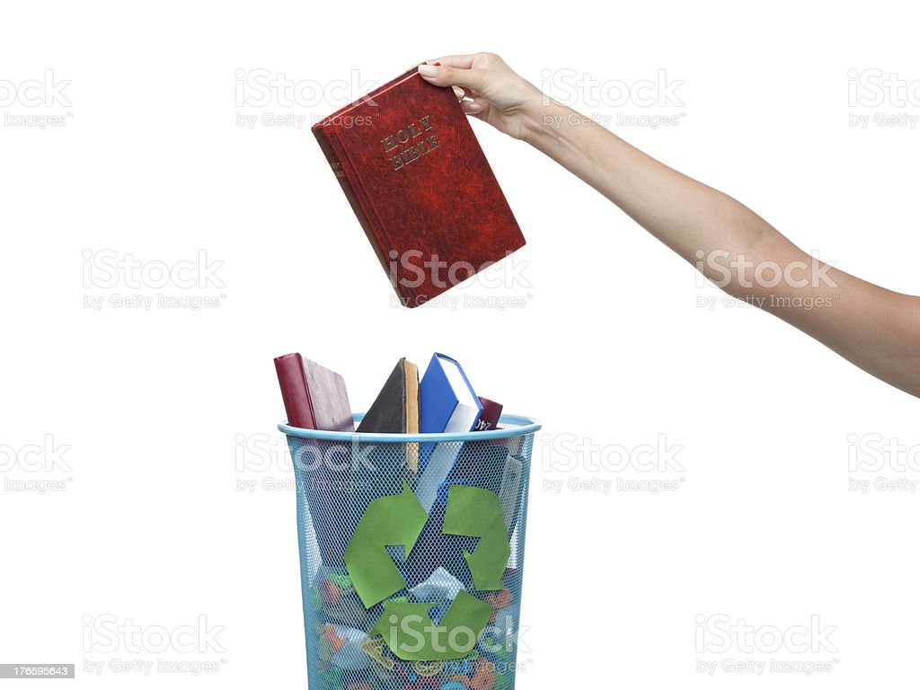 Athseist throws away bible to the recycling bin royalty-free stock photo