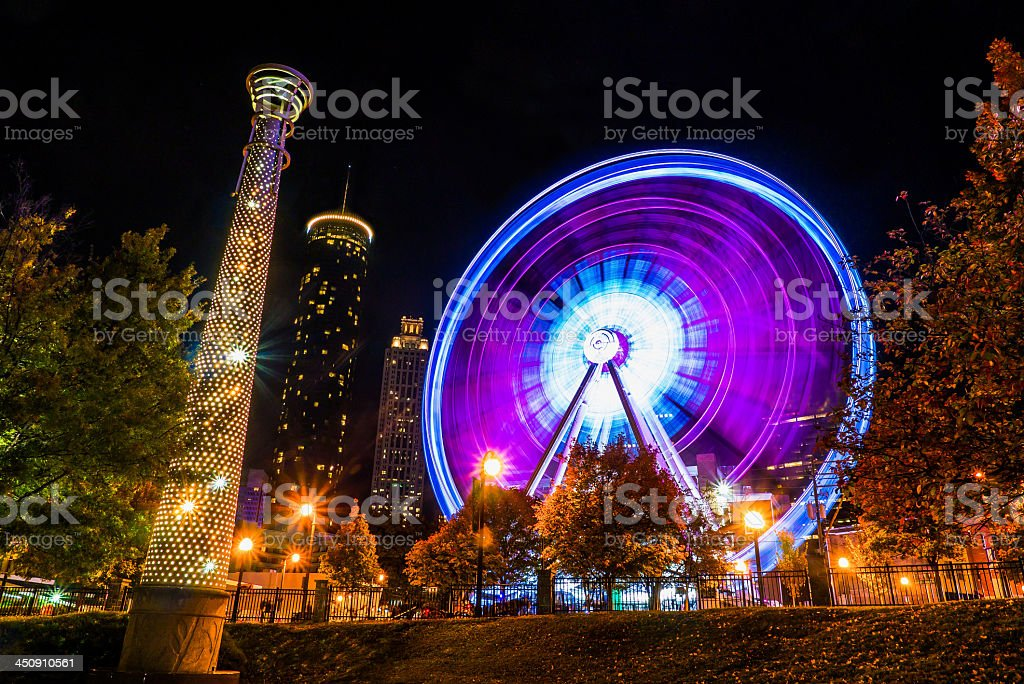 Atlanta downtown Ferris Wheel in motion lit up at night stock photo