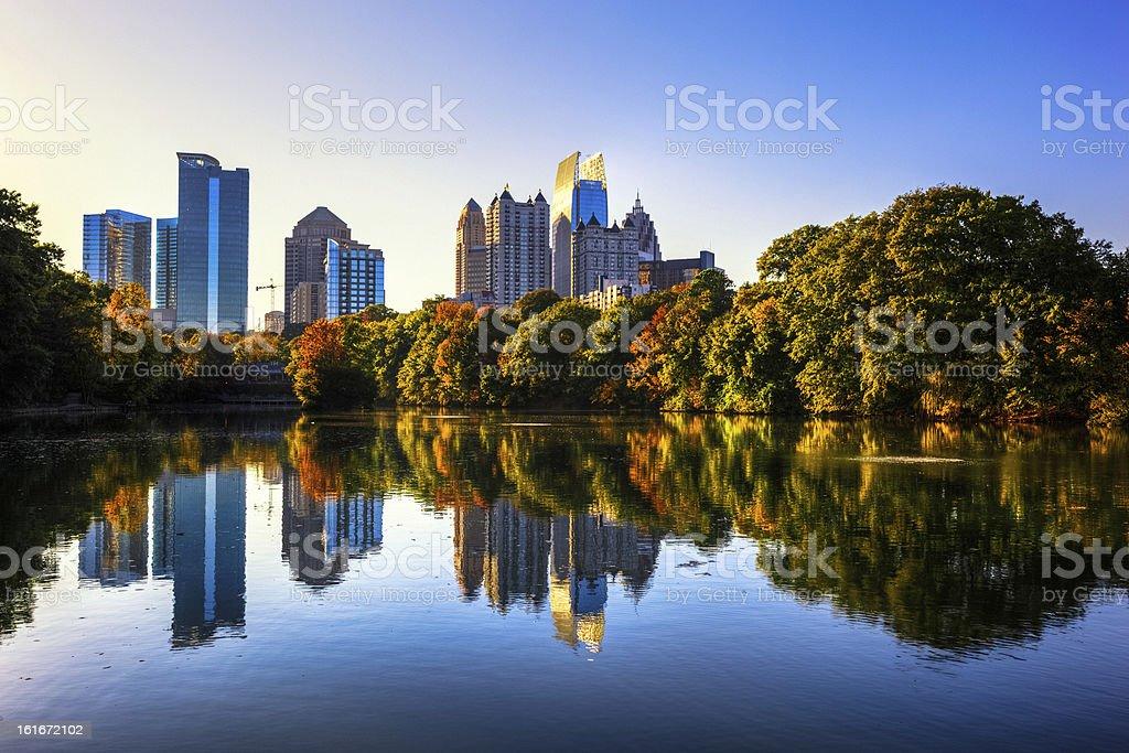 Atlanta Skyline reflected in Piedmont Park lake stock photo