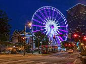 atlanta street trolley and ferris wheel