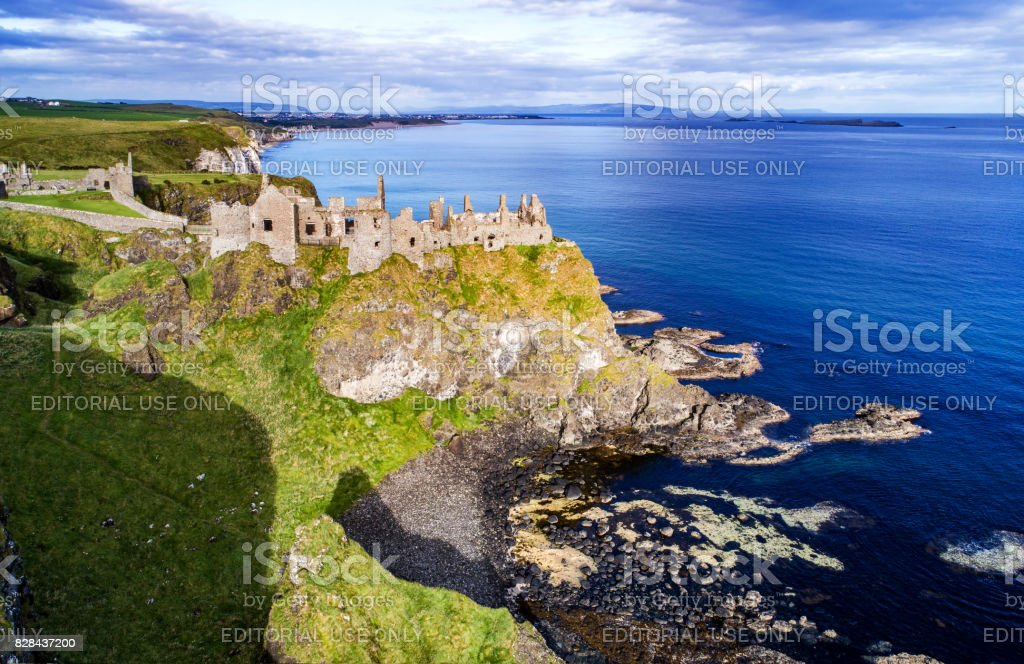 Atlantic coast in Northern Ireland with ruins of Dunluce castle. stock photo