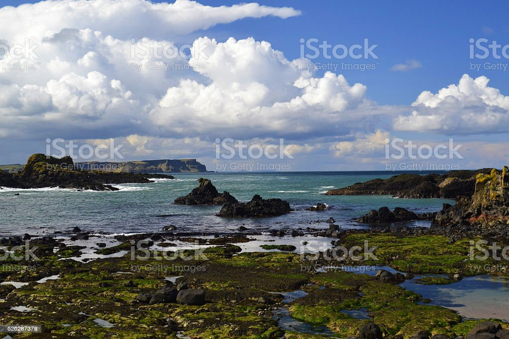 Atlantic coast with blue cloudy sky and grass before the coast stock photo
