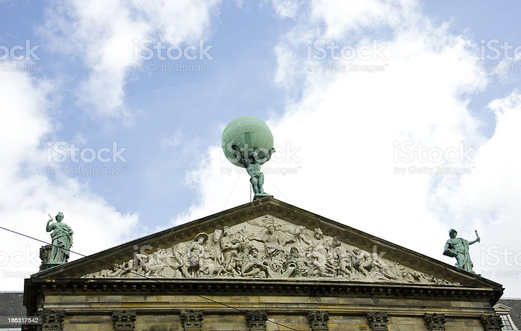 Atlas statue on the Royal Palace in Amsterdam stock photo
