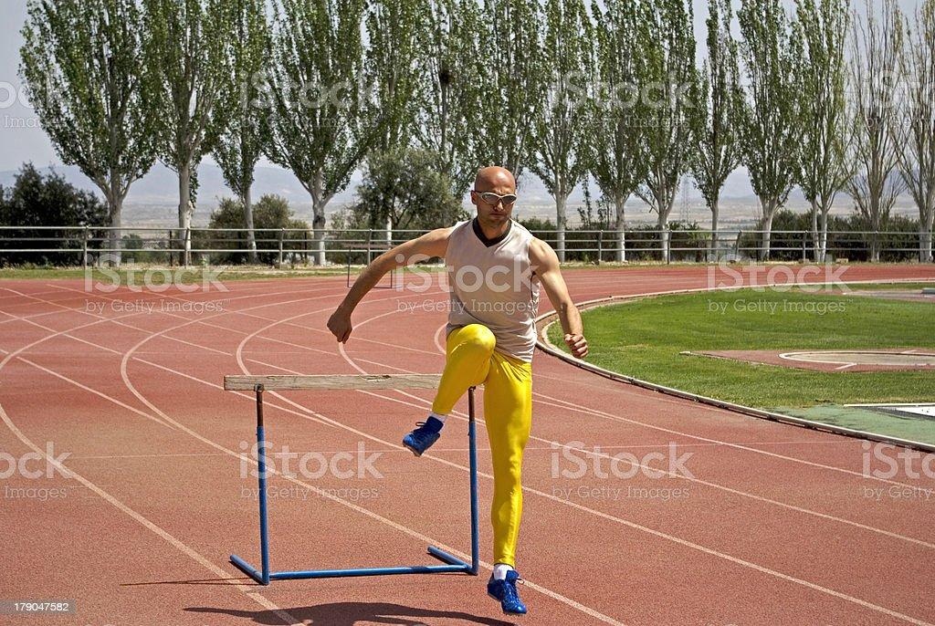 Atleta pasando vallas royalty-free stock photo