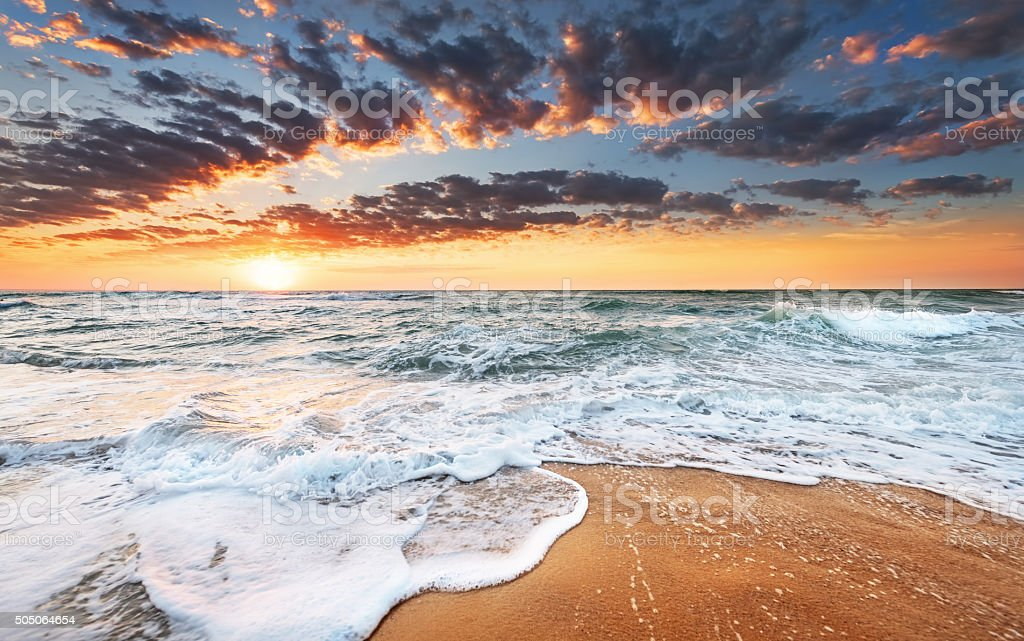 atmosphere at sunrise on the beach stock photo