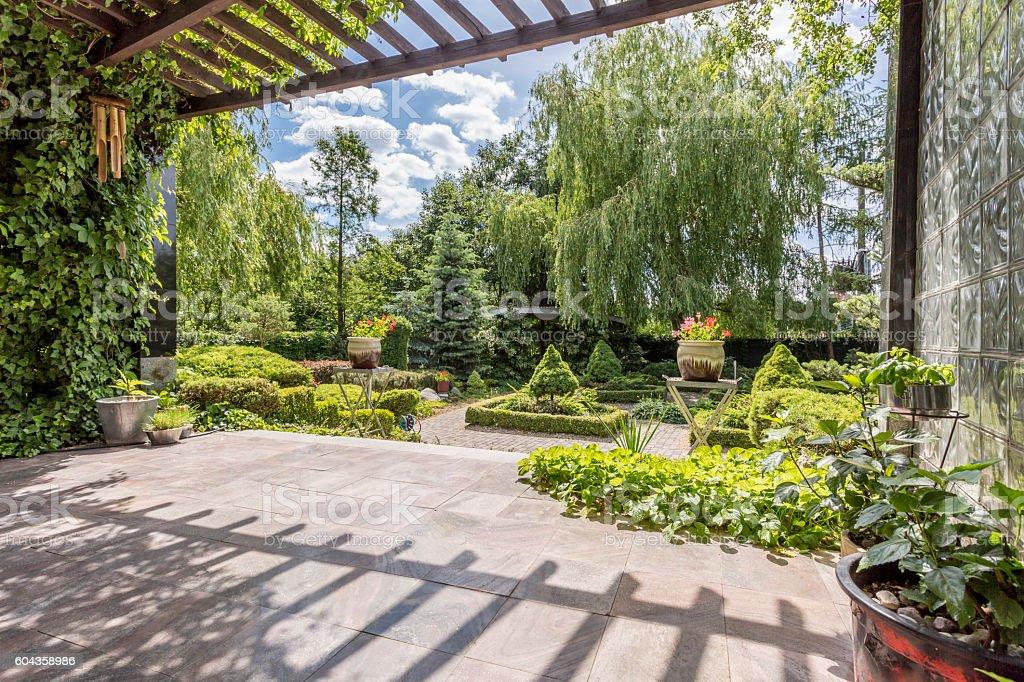 Atmosphere of Far East in luxurious garden decor stock photo