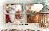 Atmospheric Christmas window with Santa Claus