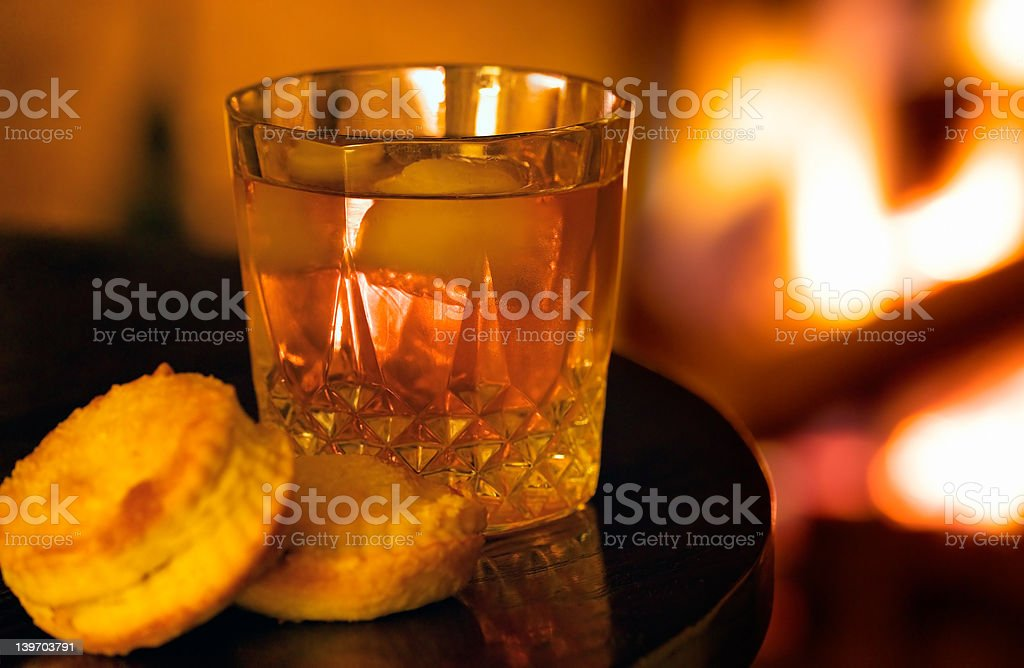 Atmospheric fireside drink with pastries royalty-free stock photo