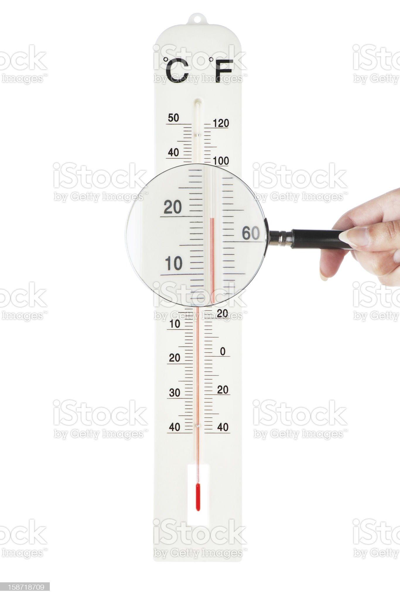 Atmospheric thermometer checked loupe for accuracy. On a white b royalty-free stock photo