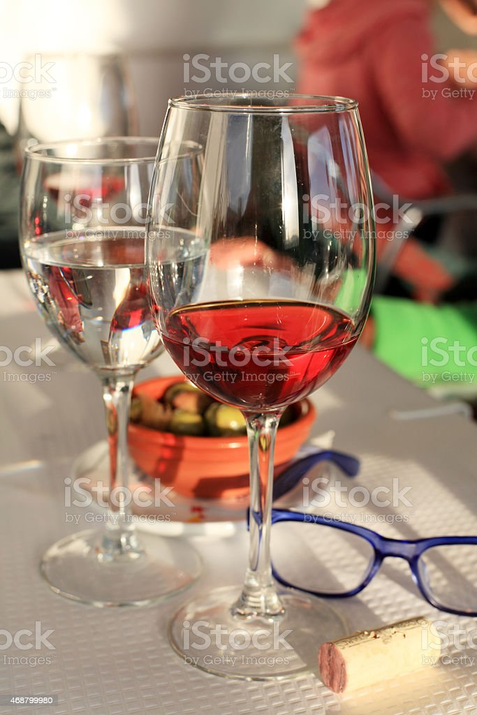atmospheric wine and olives stock photo