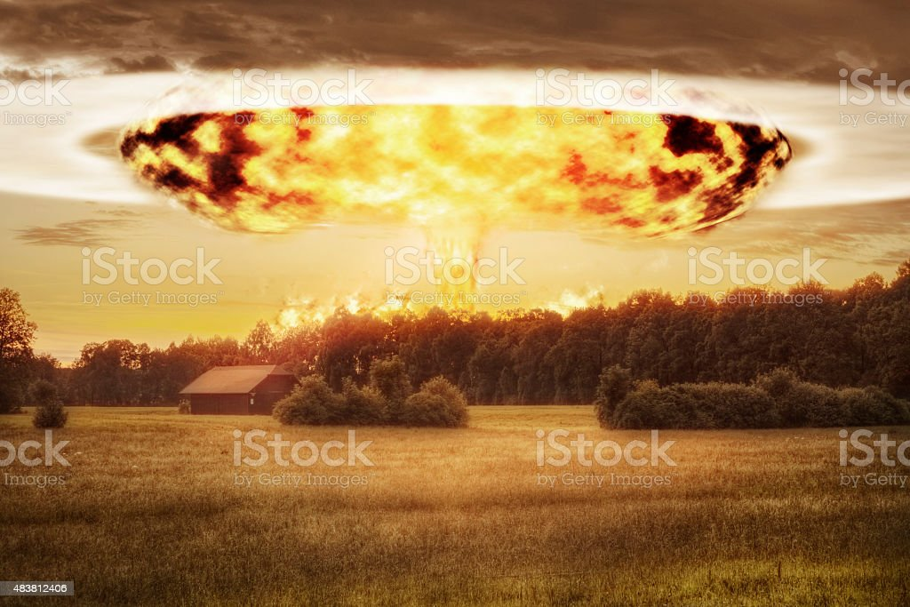 Atomic Bomb and Mushroom Cloud over Rural Landscape stock photo