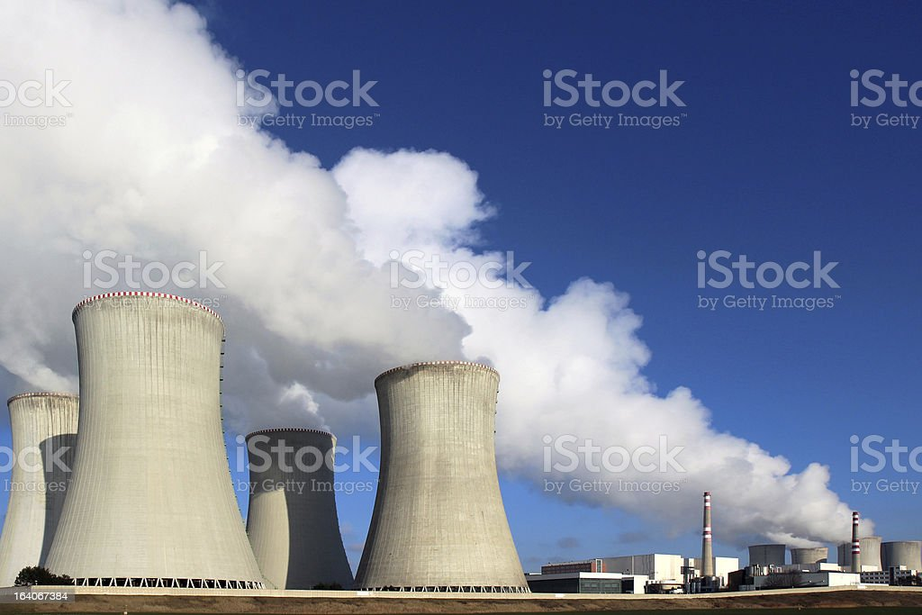 atomic power plant and huge smoke from cooling towers royalty-free stock photo