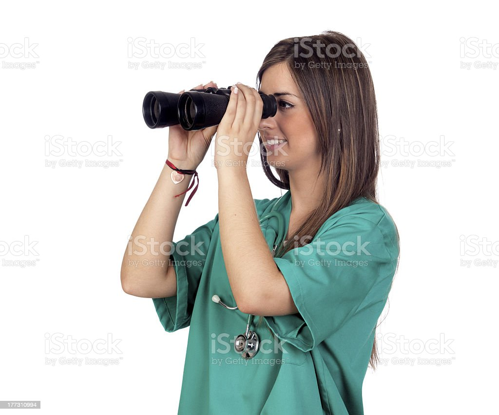 Atractive medical girl with binoculars stock photo
