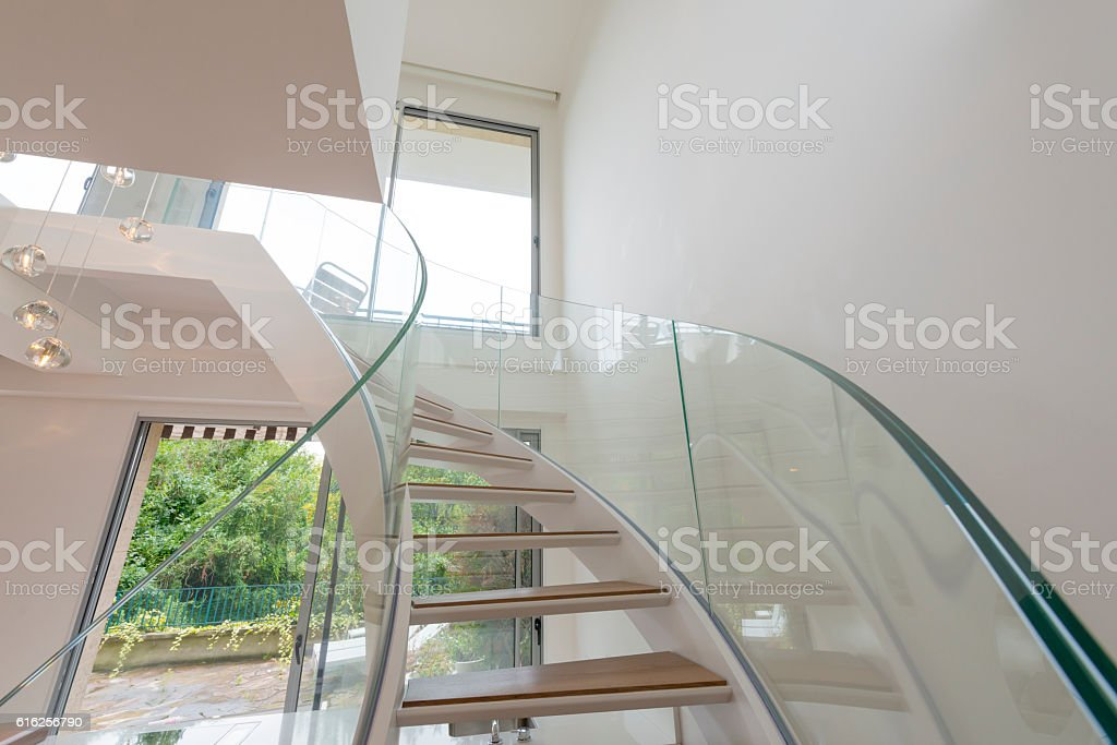 Atrium white interior with spiral staircase stock photo