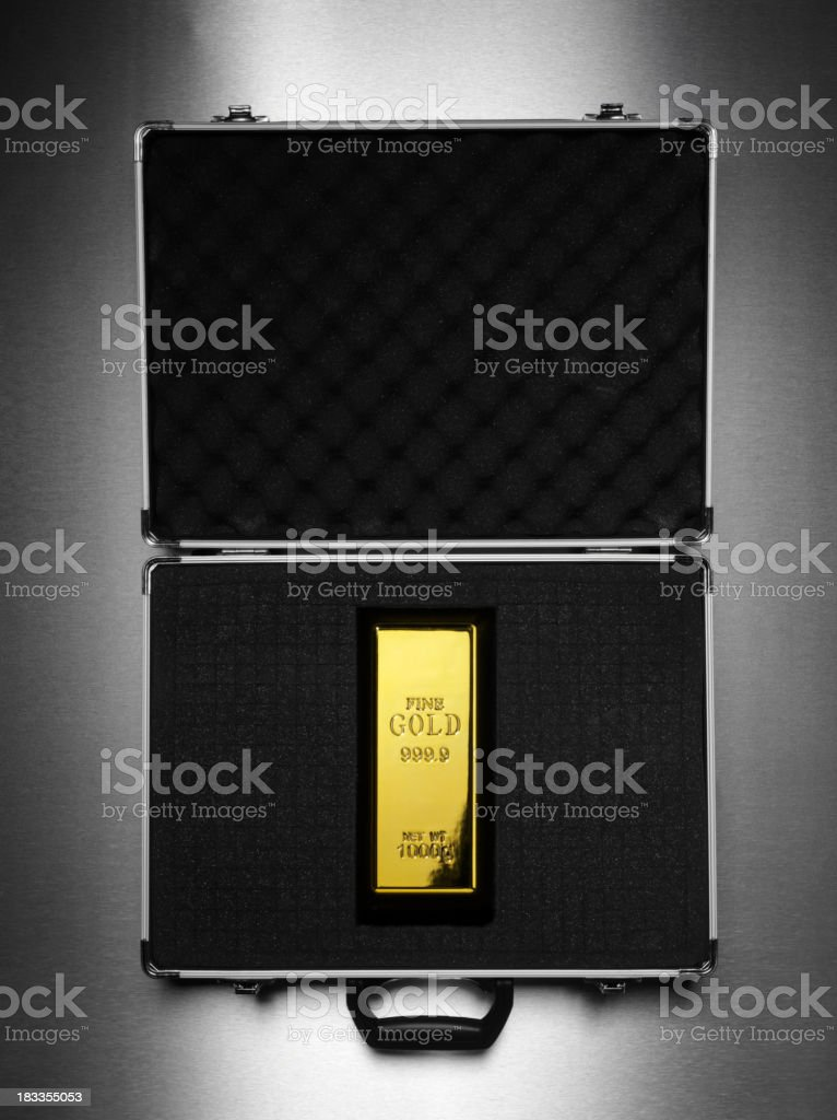 Attache Case and Gold Ignot stock photo
