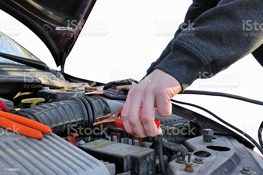 Attaching Jumper Cables (Isolated) royalty-free stock photo