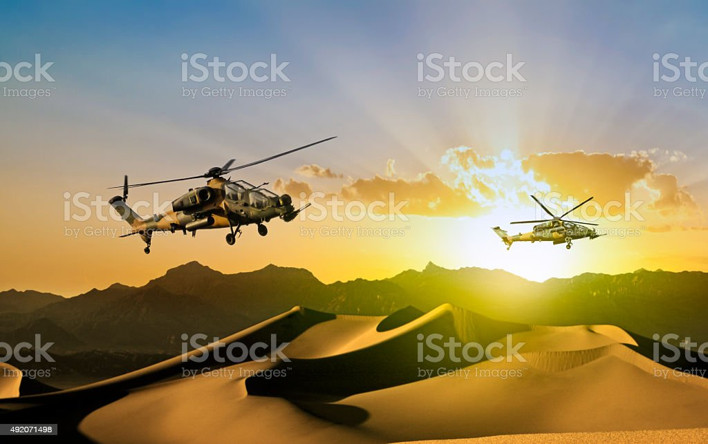 Attack Helicopters in flight stock photo