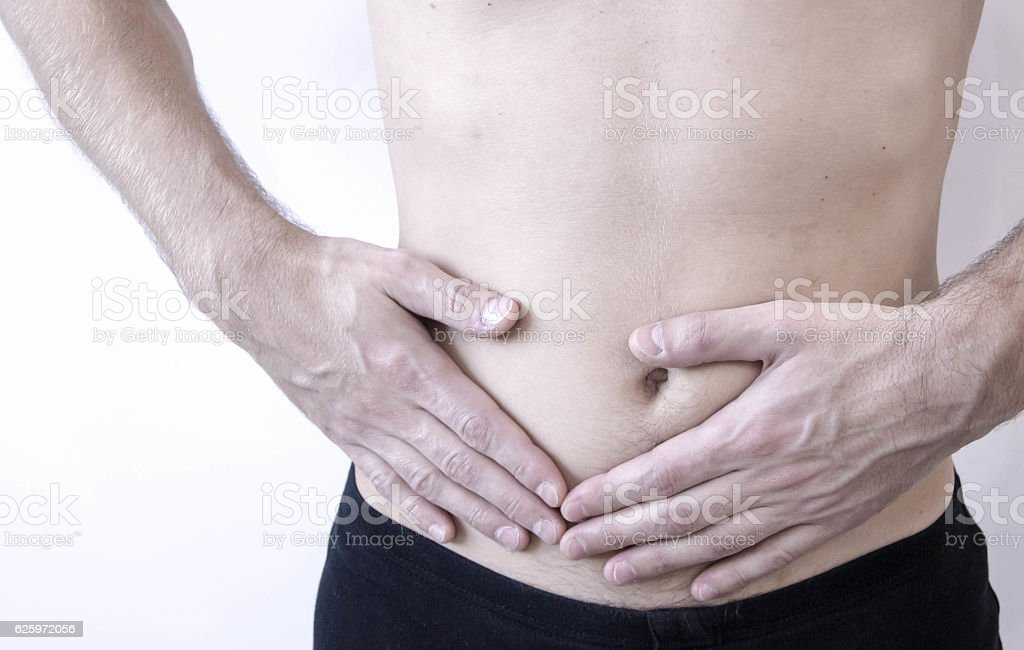 Attack of appendicitis. Pain in the right side. stock photo