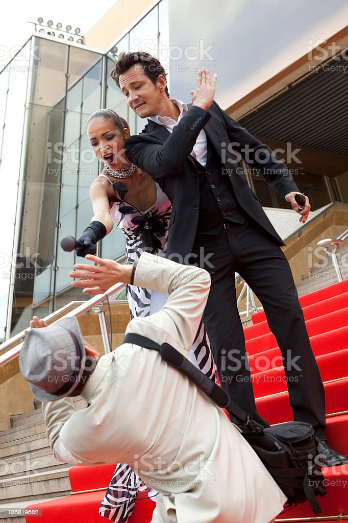 Attack reporter on red carpet royalty-free stock photo