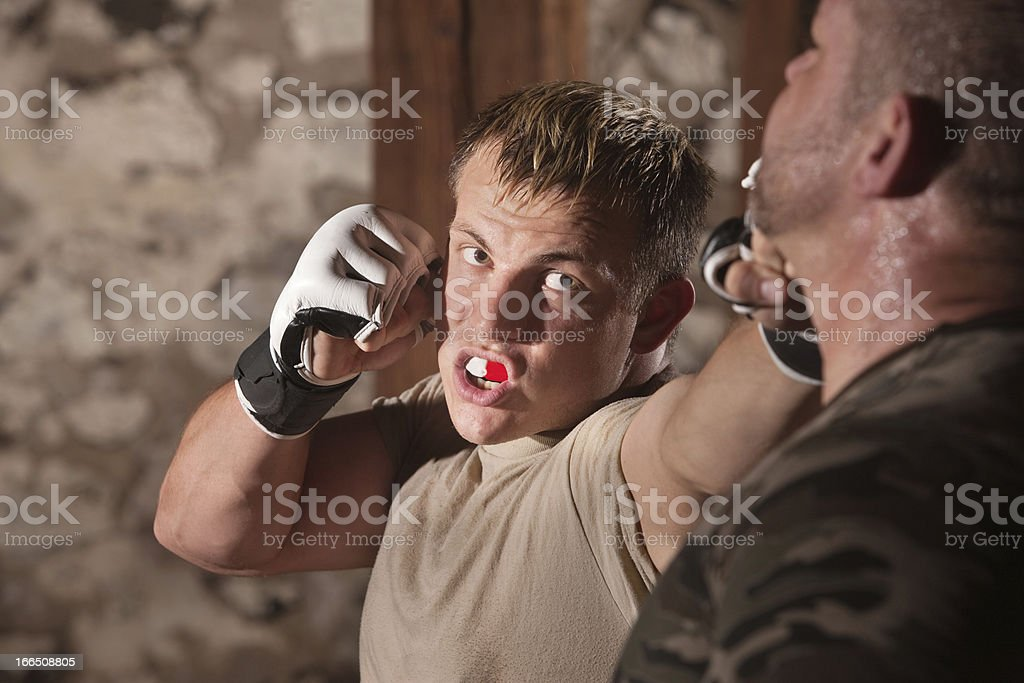 Attacker Throws Jabs at Opponent royalty-free stock photo