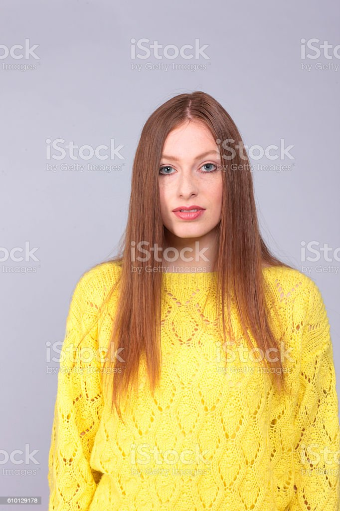 Attactive red haired woman with yellow pullover stock photo