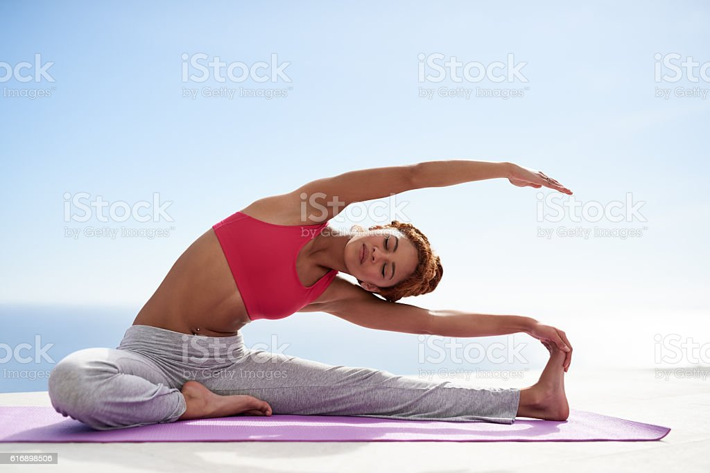 Attaining full body balance stock photo