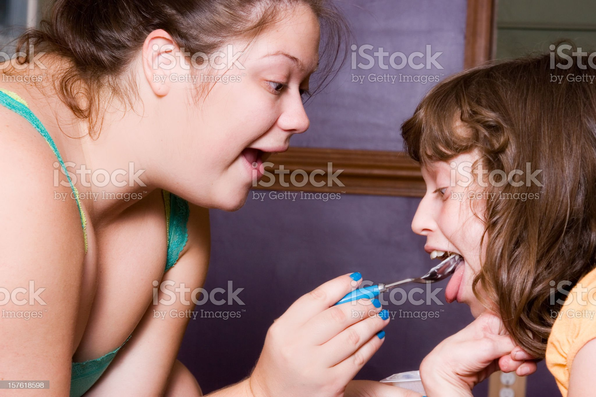 Attendant feeding special needs child royalty-free stock photo