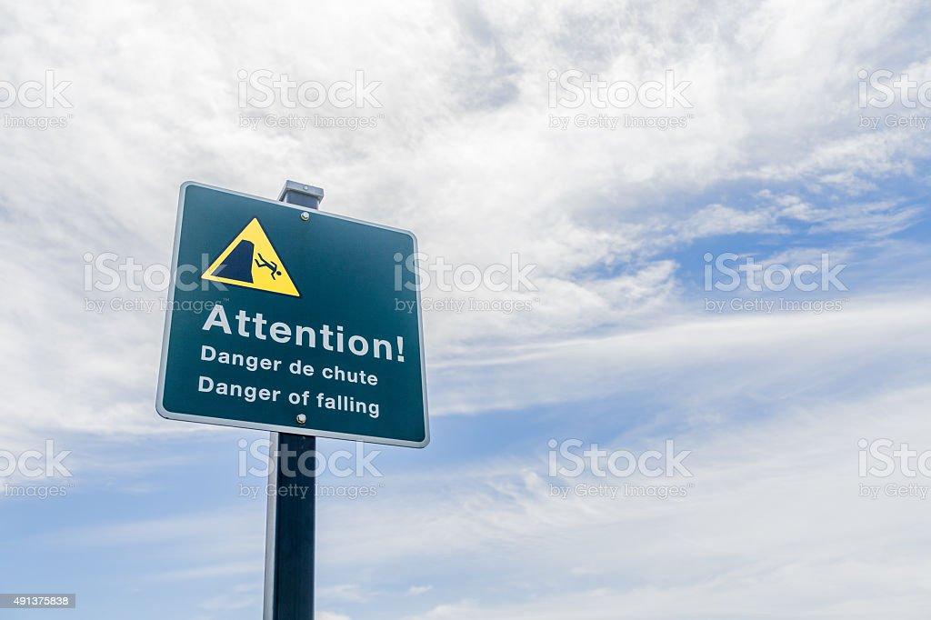 Attention Danger of Falling Left stock photo