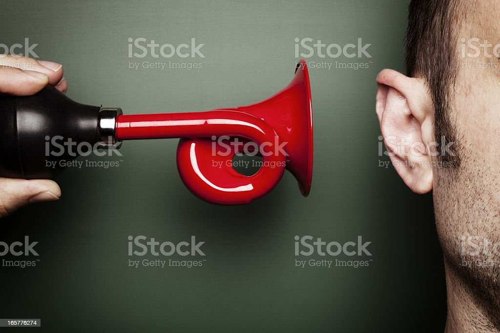 Attention Please - Signal Horn Ear Alarm Loud Scare Humor stock photo