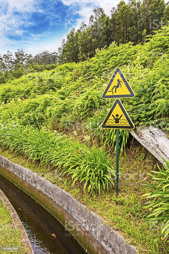 Attention sign at the water supply, Madeira royalty-free stock photo